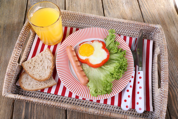 Scrambled eggs with sausage, lettuce and juice served on tray