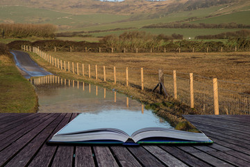 Book concept Landscape image of flooded country lane in farm