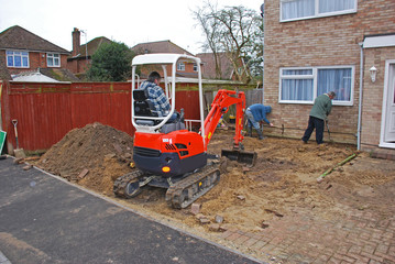 Builders digging a drive in the UK
