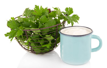 Blue metal mug with cream and parsley in metal basket