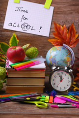 time for school concept with text on wooden background