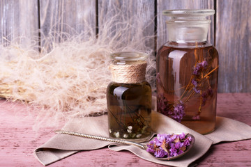 Bottles of herbal tincture and brunch of flowers