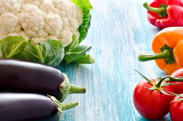 Different vegetables on wooden background copy space for text