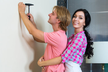 Couple together has small home repairs