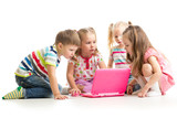 group of children friends looking at the laptop