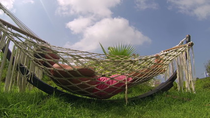 Man Relaxing In A Hammock On The Beach