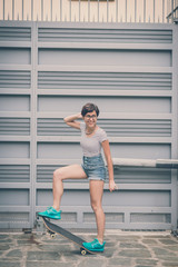 young hipster woman with skate