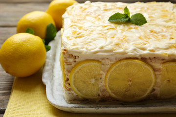 Tasty lemon cake on table at home