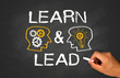 learn and lead concept on chalkboard