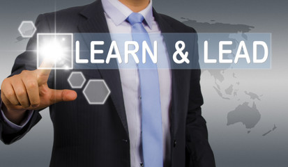 learn and lead:business man touching screen interface
