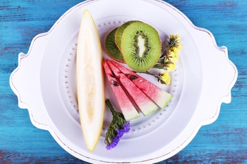 Slices of melon, kiwi and watermelon in plate