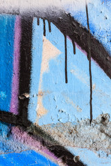 Close up of blue graffiti and dripping paint
