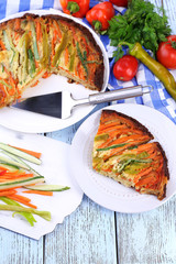 Casserole with vegetables on plate on table close-up
