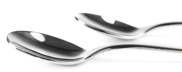 Metal coffee spoons isolated on white