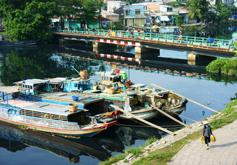 boat on polluted water of Vietnam canal