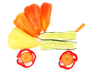 Fresh organic vegetables and fruits in shape of pram isolated
