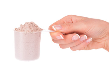 Female hand holding scoop with whey protein powder isolated