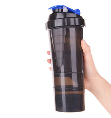 Female hand holding plastic shaker with protein shake isolated