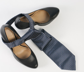Female shoe and neck tie