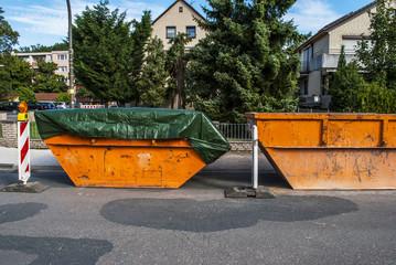 Road reconstruction - rubbish skip