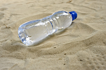 a water bottle in the sand