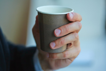 men with cup of coffee