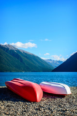 A recreation area with a couple colorful kayaks