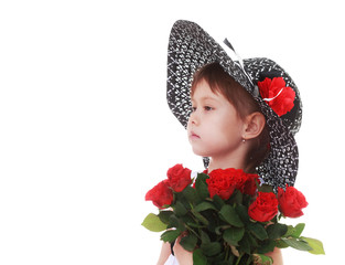 girl in a hat big bouquet of red roses