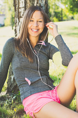 woman doing sports and listening to music outdoors
