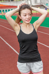 Chinese woman on sports track preparing