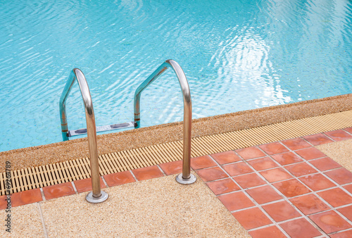 Ladder of swimming pool in summer time poster