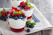 Yogurt dessert with jelly and fresh berries