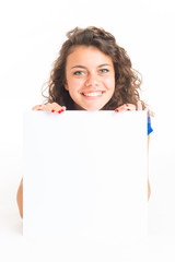 Young cute woman holding a white card