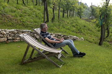 Man is relaxing in the vineyards of Prosecco