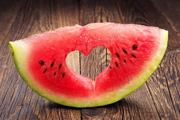 Watermelon slice with cut in the shape of heart