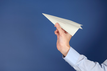 Paper plane in the hand