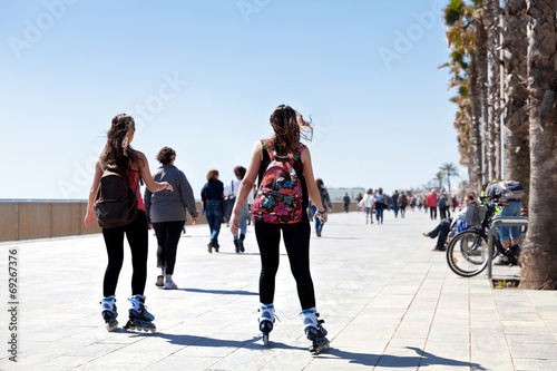 Rollerblading on the beach. - 69267376