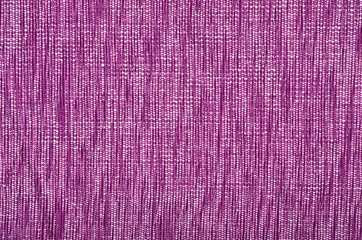 Purple material as background. Pink woven with threads pattern.