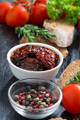 sun-dried tomatoes in a bowl and various appetizers