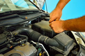 Auto mechanic during automobile car maintenance service