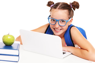 Smart schoolgirl with laptop