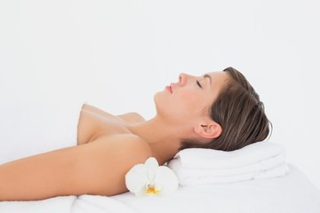 Side view of a beautiful woman on massage table