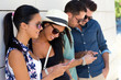 canvas print picture - Portrait of group of friends having fun with smartphones.