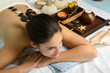 Young beautiful woman in spa environment gets massage