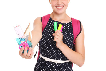 Midsection of a schoolgirl with set of stationary