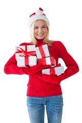 Festive blonde holding many presents