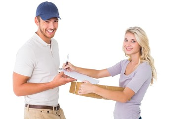 Happy delivery man giving package to customer