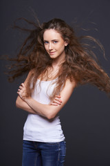 Woman posing with hair fluttering in the wind