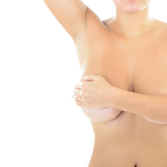 Body of beautiful woman covering her breast and showing armpit,