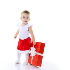 Holidays, baby girl holding a present, christmas, birthday, new